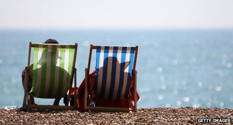 Two deckchairs looking out over the sea