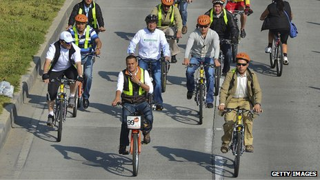 People take part in the Ciclovia in Bogota, Colombia
