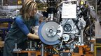  A worker builds an engine for a Ford Focus on the assembly line at Ford Motor&#039;s Michigan Assembly Plant in Wayne, Michigan.