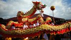 A Chinese dragon performs during the Taniwha and Dragon Festival at Orakei Marae in Auckland, New Zealand