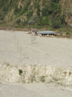 Village remains buried under silt