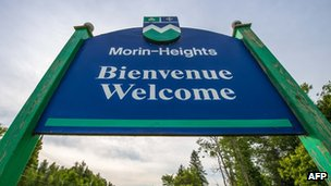 "A French-English ""welcome"" signs in the Laurentian Mountains of Quebec"
