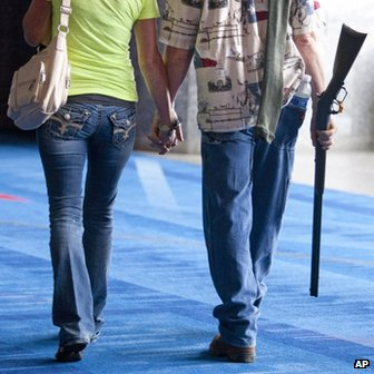Barry Bailey and his wife Judy, of DeRidder, Louisiana, walk out hand-in-hand after having their 1873 Winchester shotgun appraised at the NRA antiques guns showcase at the NRA meeting in Houston, Dallas, on 2 May 2013