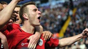 Wigan celebrate Callum McManaman's goal