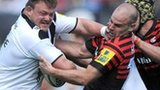 Bath's David Wilson takes on Saracens' Charlie Hodgson