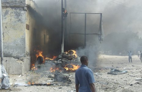 A car burns after the bomb attack in Mogadishu, 5 May