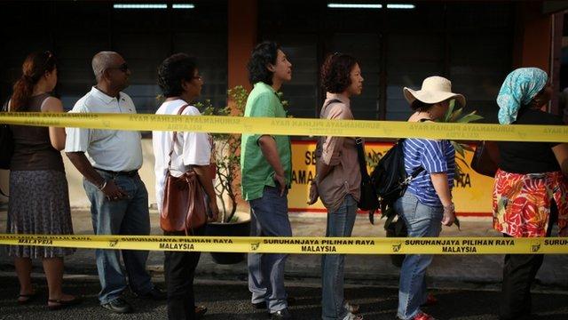 Voters queue in Kuala Lumpur