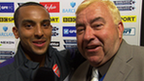 Arsenal's Theo Walcott and BBC commentator Jonathan Pearce