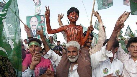 Boy painted as a tiger at Sargodha rally