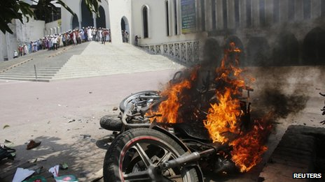 Burned motorcycles are seen after the clash in front of the national mosque in Dhaka, 5 May 2013