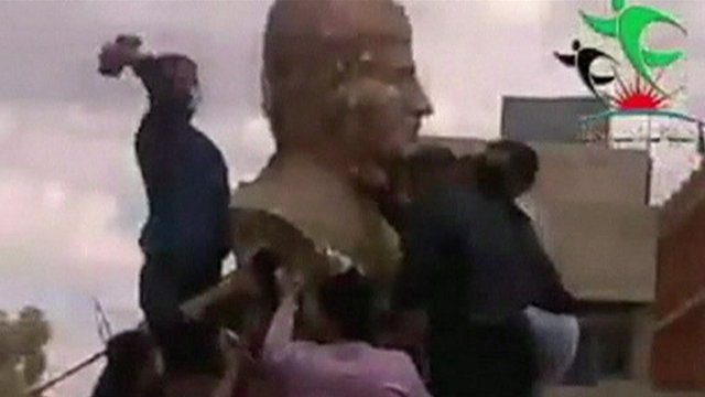 Syria conflict: Head torn off Assad father statue