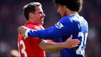 Jamie Carragher and Marouane Fellaini