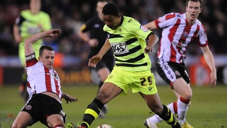 Sheffield United's Michael Doyle (left) tackles Yeovil's Angelo Balanta in Friday's first leg