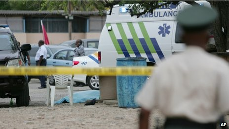 Forensic investigators examine the crime scene on 5 May 2013