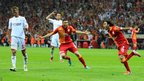 Galatasaray's Burak Yilmaz (second right) and Selcuk Inan (right) celebrate a goal in the victory against Sivasspor that sealed their club's record 19th league title