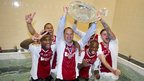 Ajax head coach Fran de Boer celebrates his club-record equalling third successive league title in a pool with his players