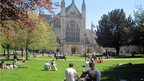 People enjoying the ban holiday sun at Winchester Cathedral