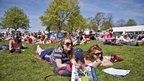 People relax in the Bank Holiday sun during day five of the Badminton Horse Trials in Badminton, Gloucestershire