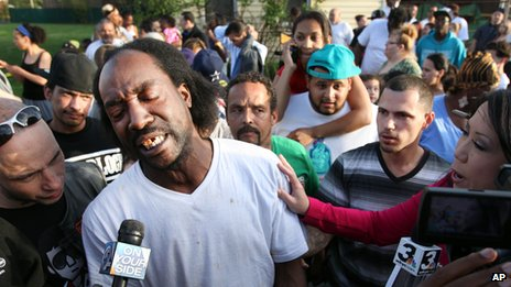 Neighbour Charles Ramsey talks to the media near Seymour Avenue in Cleveland, Ohio, on 6 May 2013