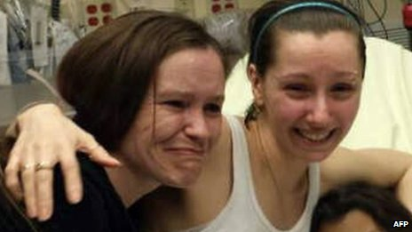After disappearing a decade ago at the age of 16, Amanda Berry (centre) is finally reunited with her sister (left).