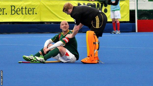 Guernsey skipper Matt Watson is consoled after the loss