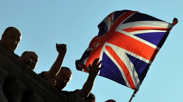 Workers fly the Union Flag