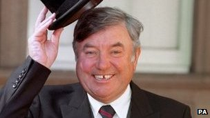 Comedian Jimmy Tarbuck at Buckingham Palace after receiving his OBE