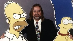 Matt Groening with cut-outs of Homer and Marge Simpson in 1996