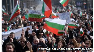 Protesting crowds wave Bulgarian flags in March