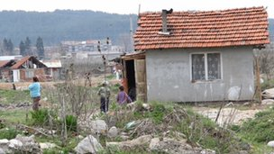 Children play beside a run-down home on a Roma settlement in Bulgaria.