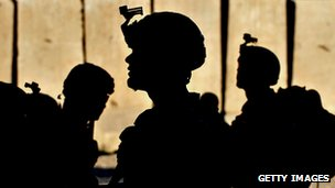 Silhouette of US army soldiers in combat gear