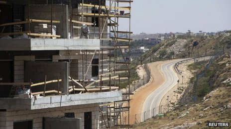 A builder works on a block of flats at a Jewish settlement near Jerusalem known as Har Homa (7 May 2013)