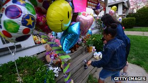 Well-wishers deliver a token of respect outside the home of Amanda Berry's sister