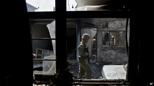 A soldier examines houses in Ecatepec after a gas tanker exploded on 7 May 2013