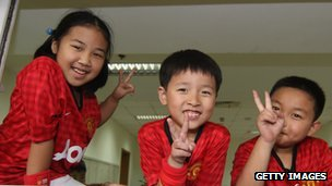 Young Manchester United fans in Shanghai, China, in 2012