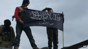 Rebels from al-Qaida affiliated Jabhat al-Nusra waving their brigade flag at Taftanaz in northern Syria. Photo: January 2013