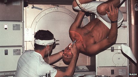 Commander Pete Conrad in zero gravity on Skylab