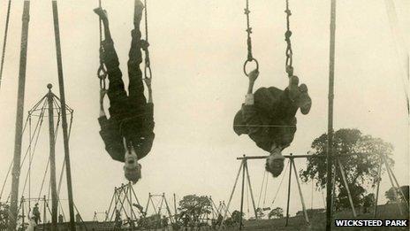 Boys upside down on playground equipment