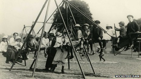 Children on swings in 1920s