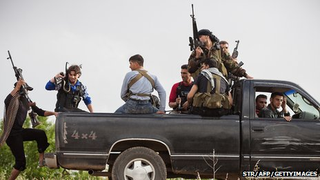 Members of Free Syrian Army patrol Qusayr, near Homs, on 10 May 2012