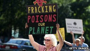 Protestors hold signs against fracking during a demonstration outside of the California Environmental Protection Agency