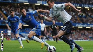 Garth Bale (right) in action against Chelsea