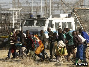 Protesting miners approach the police before they were fired upon near the Marikana mine on 16 August 2012