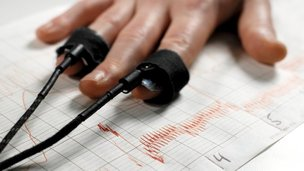 Hand with polygraph machine