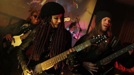 Students playing in a heavy metal band.