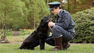 Lincoln University graduate Mark Brewer as Guy Gibson with his labrador