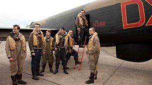 Actors before a Lancaster Bomber
