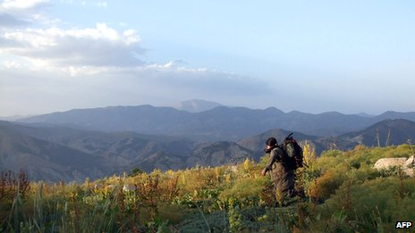 A PKK fighter is seen in an undisclosed mountainous region in Turkey near the border with Iraq, in this handout photo dated 9 May 2013