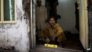 A Pakistani Christian repairs his home destroyed by mobs of radical Muslims in the Joseph Colony area.  a Pakistani Christian repairing his home destroyed by mobs of radical Muslims in Joseph Colony