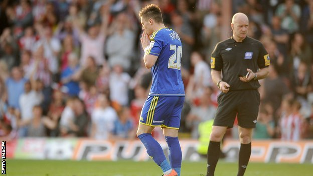 Miles Storey reacts to missing a penalty against Brentford